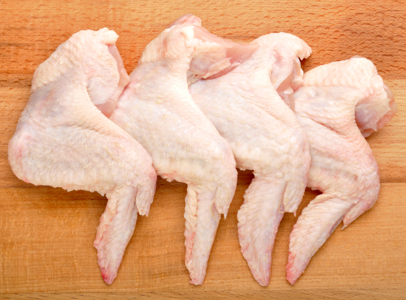 There are many ways to cook chicken wings, partially because they are a versatile and inexpensive option for feeding large groups of people. Nearly all cooking methods can be used for chicken wings, in part because they are relatively small cuts of meat.